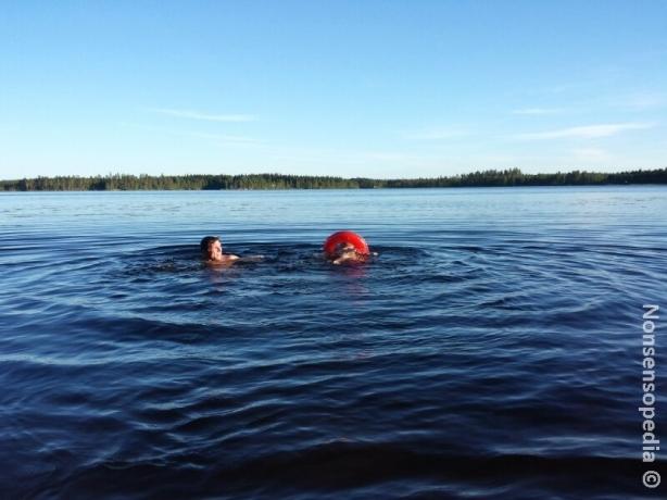 Isä ja poika veden varassa